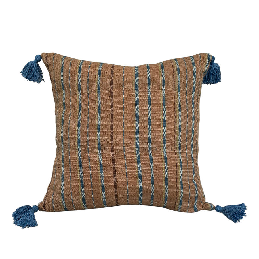 Ginger ikat cushion with blue tassels