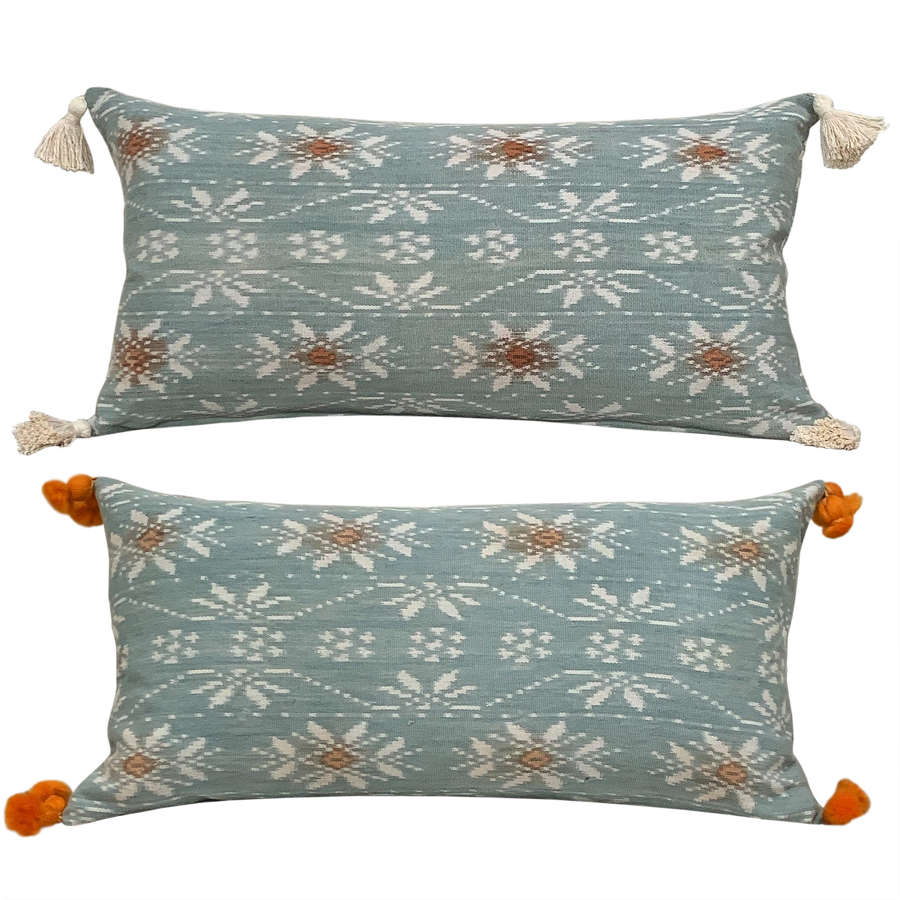 Rote ikat cushions with tassels