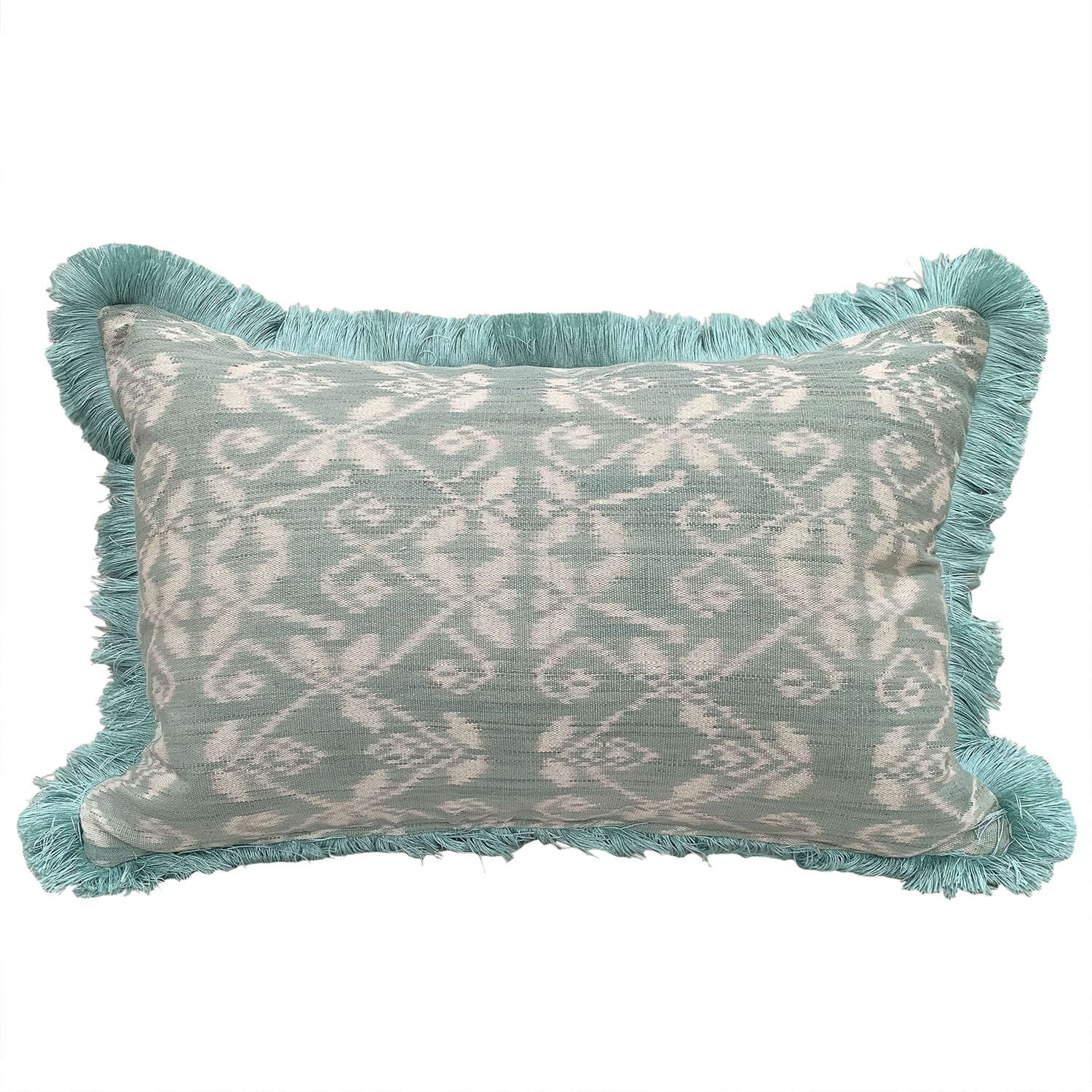 Rote ikat cushions with fringe trim