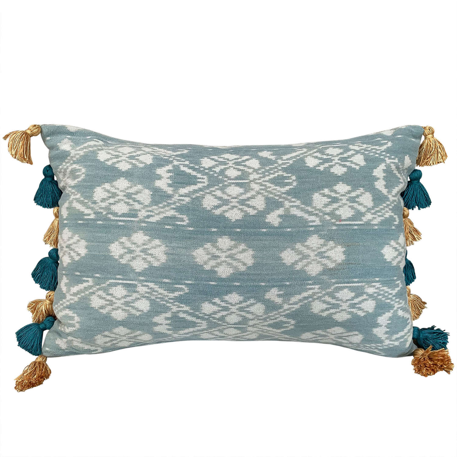 Rote ikat cushions with tasselled sides