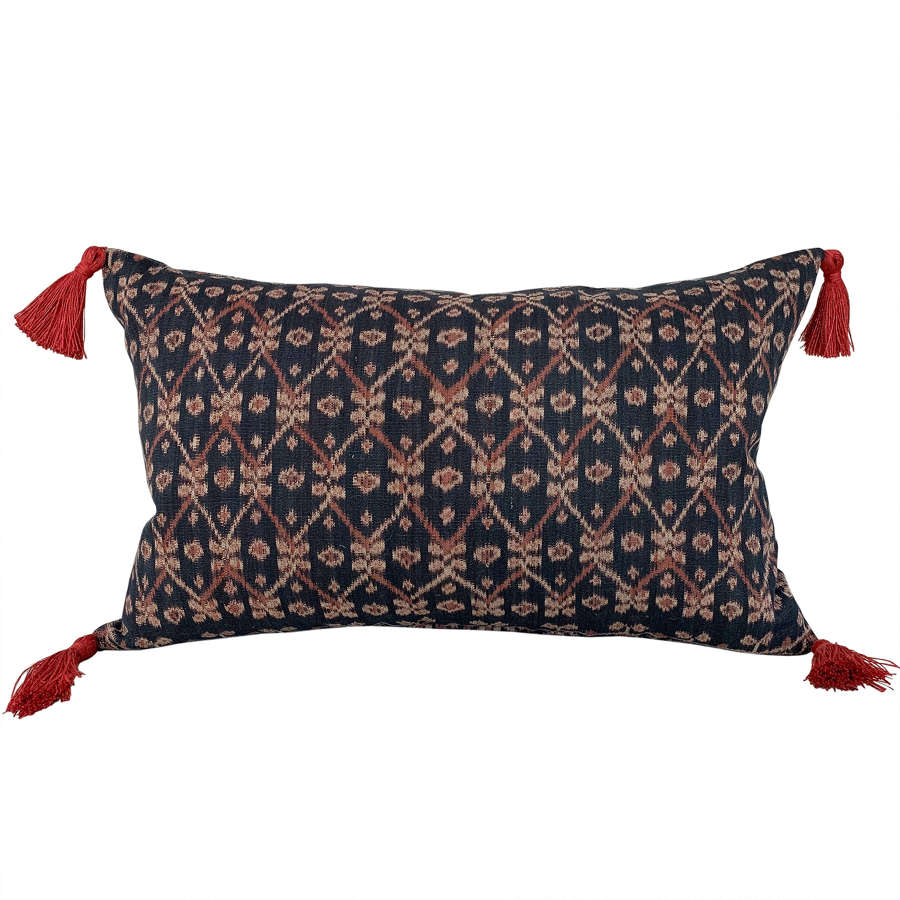 Flores ikat cushions with rust coloured tassels
