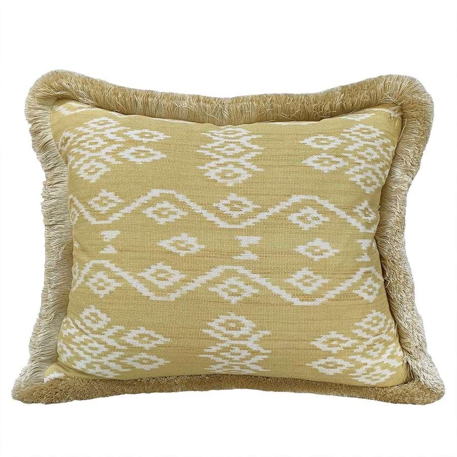 Rote ikat cushion with brush fringe