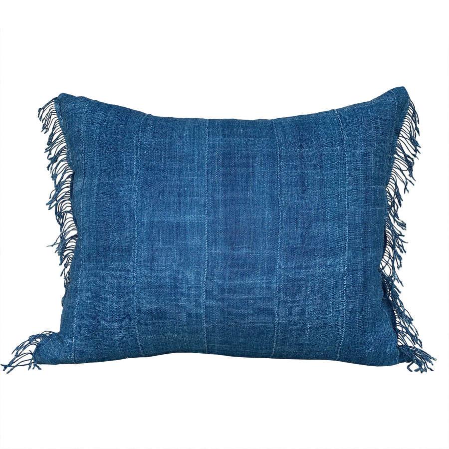 Indigo Mossi cushions with fringed sides