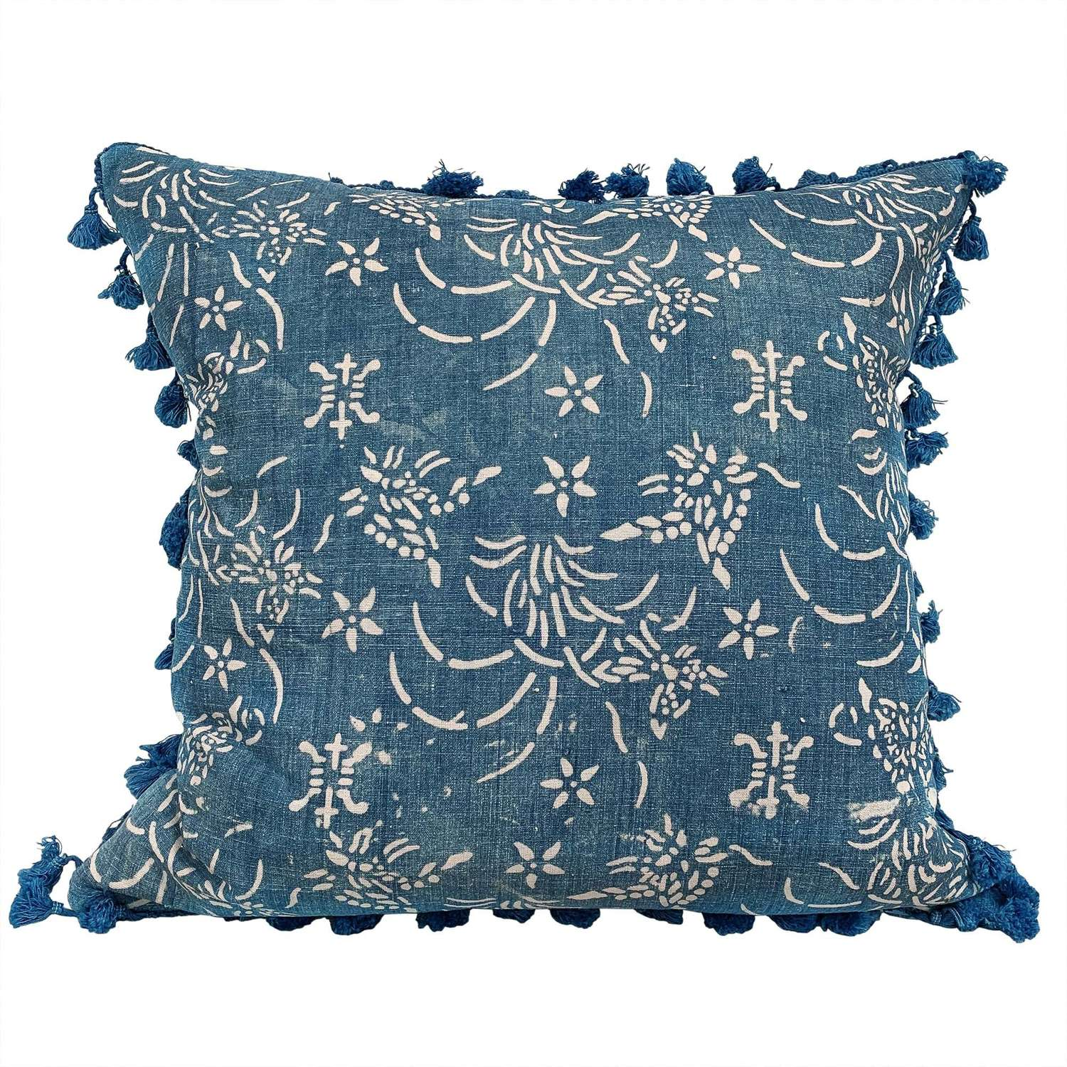 Indigo resist cushion with tassel fringe