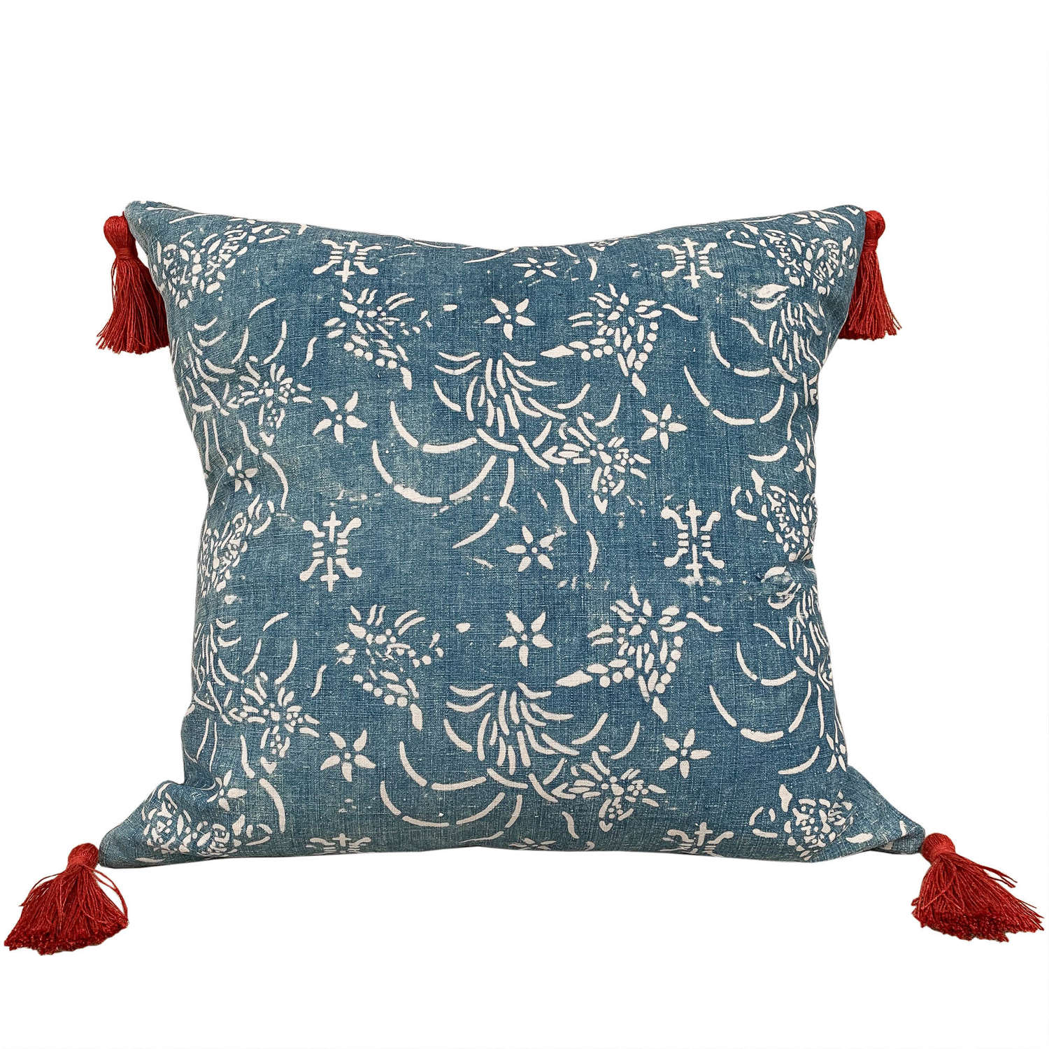 Indigo resist cushions with rust tassels