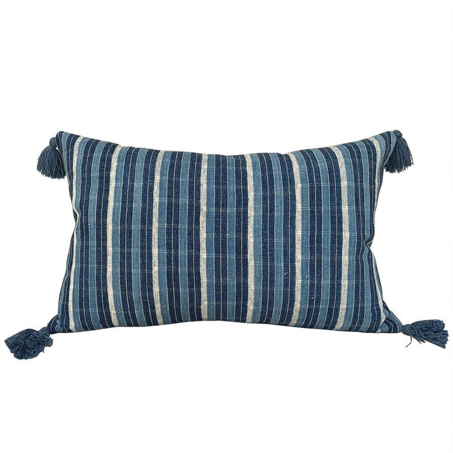 Ivory Coast cushion with tassels