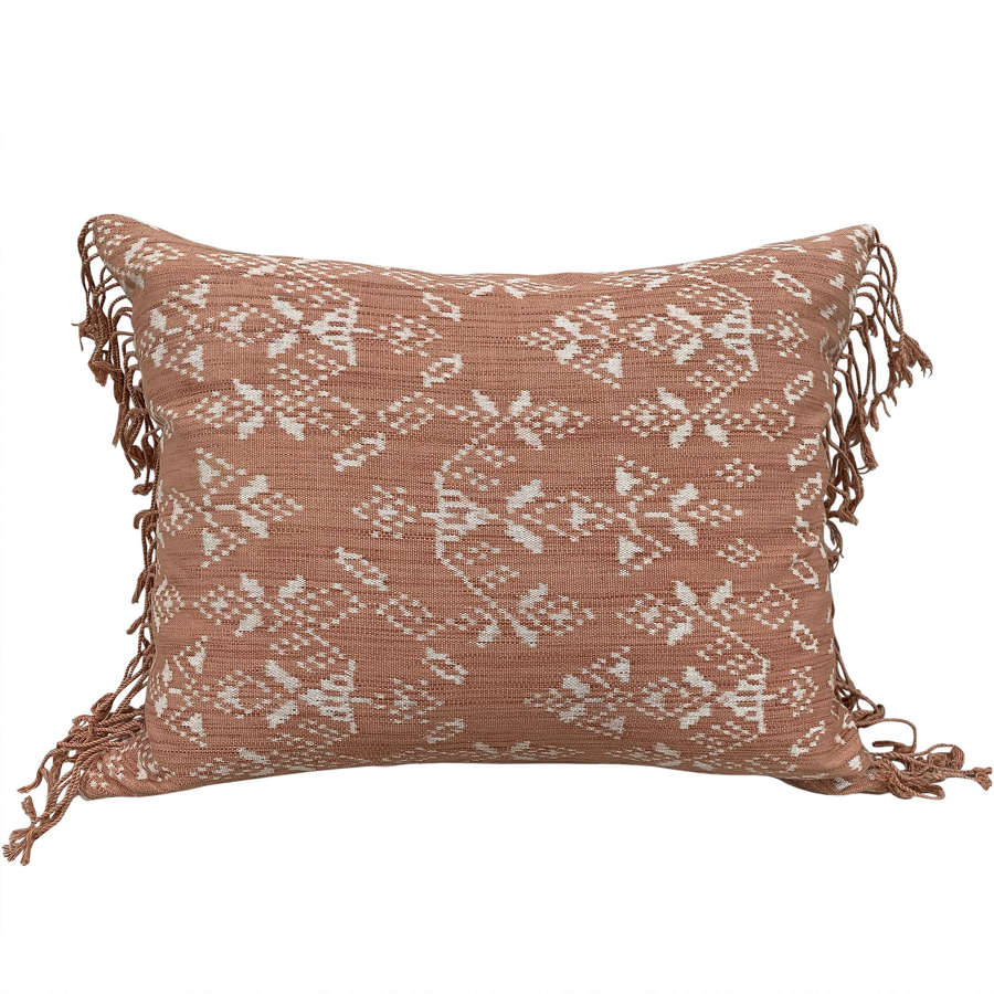 Coral Rote ikat cushions with fringed ends