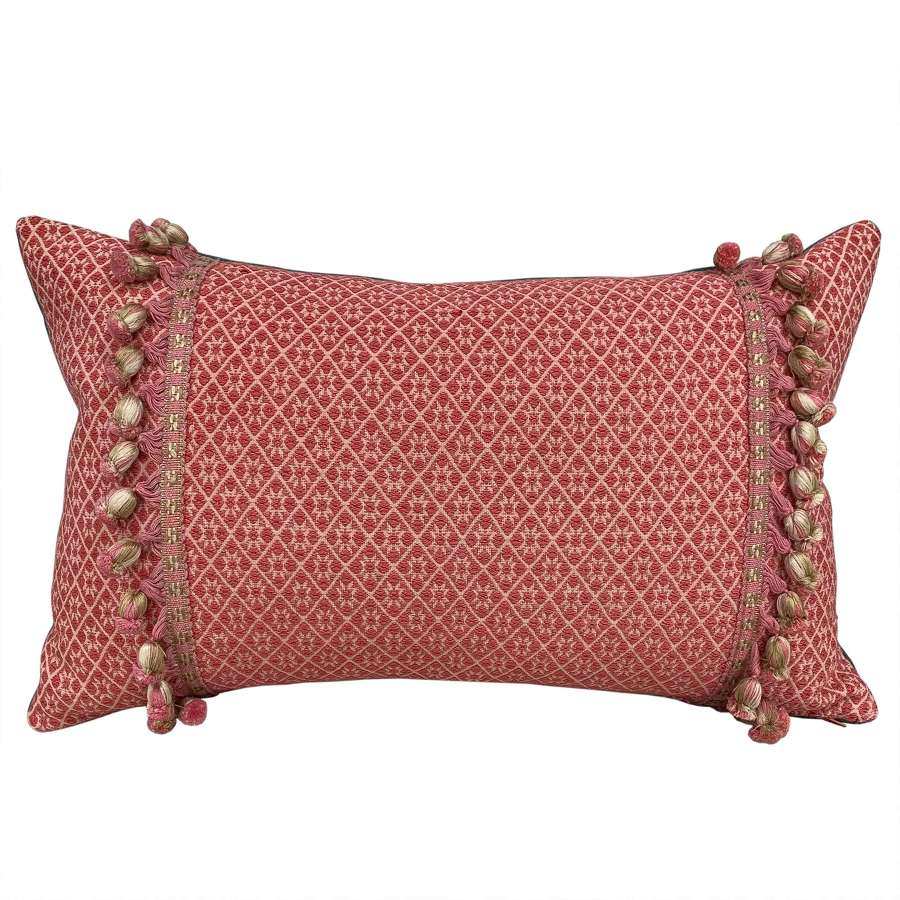 Coral Zhuang cushions with bobble trim