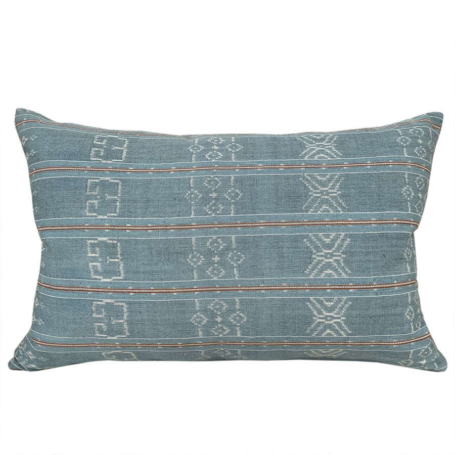 Pale blue Flores ikat cushions