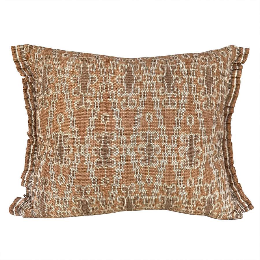 Dayak ikat cushions, ochre