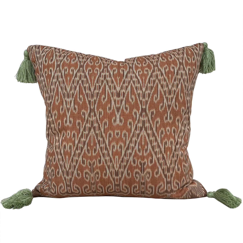 Dayak cushions with green tassels