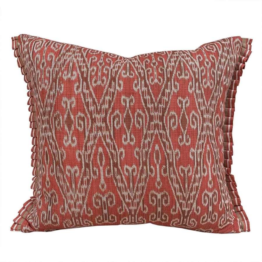 Dayak ikat cushions, deep coral