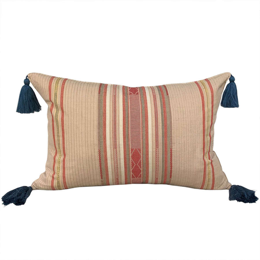 Beige Lombok cushions with blue tassels