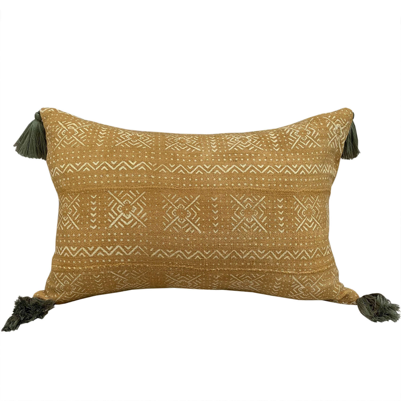 Yellow mud cloth cushions with green tassels