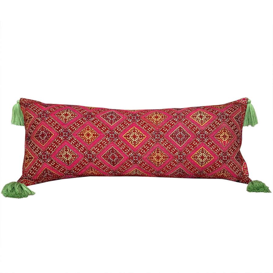Swat cushion with green tassels