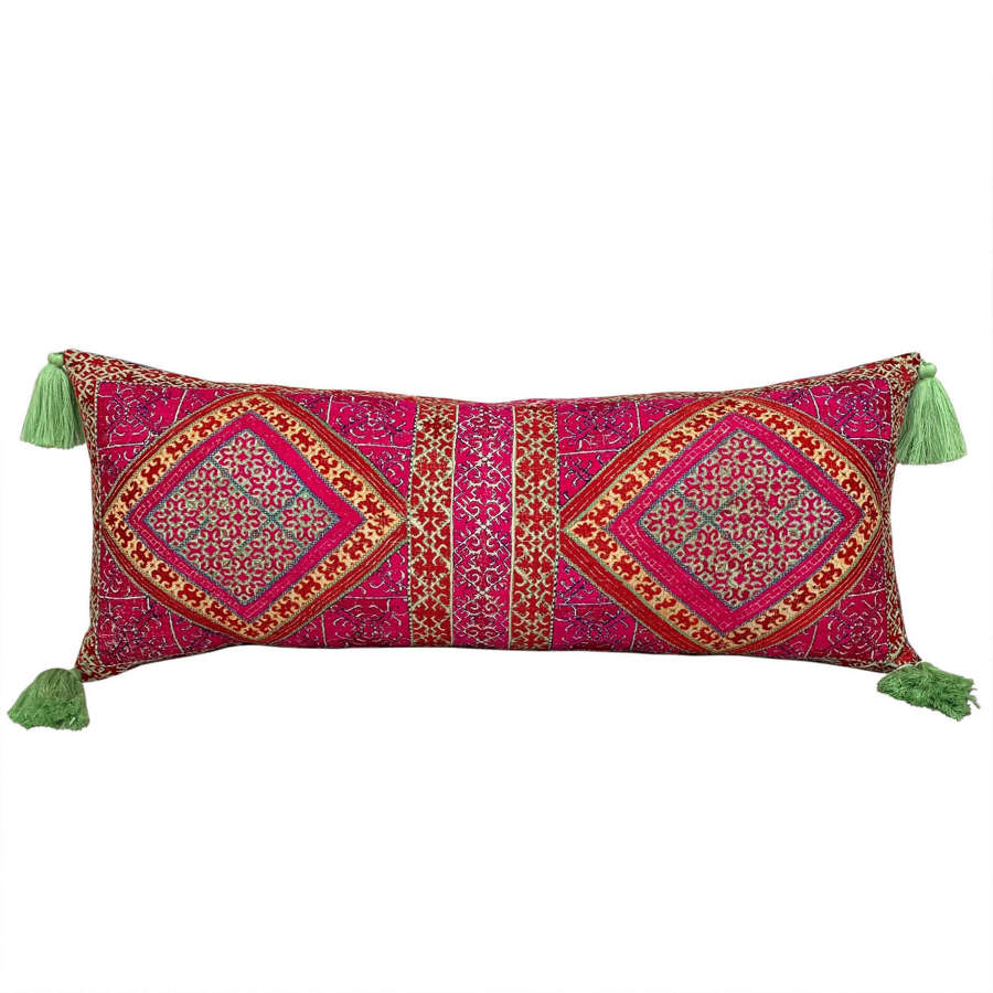 Swat pillow with green tassels